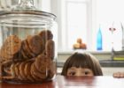 kid peeking at cookie jar