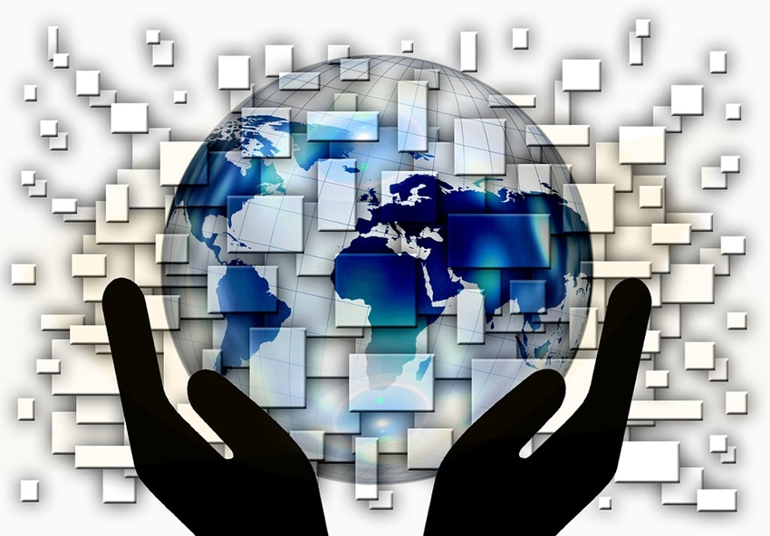 two hands holding globe
